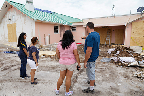Volunteers from parishes throughout the Archdiocese of Miami inspect the grounds in September 2017 at the archdiocesan church most devastated by Hurricane Irma, St. Peter the Fisherman in Big Pine Key. The church was deemed unusable.