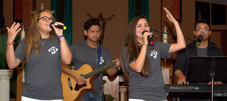 Serina Cotto, left, and Marcella Osorio sing, with Gerard Calilung on guitar and Jonathan Gaus on keyboard.