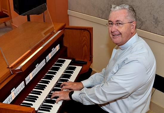 Msgr. Terence Hogan, dean of theology at St. Thomas University, has taught music and even plays organ.