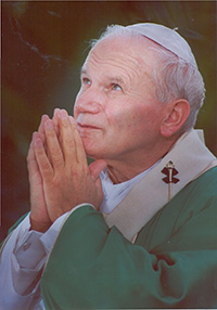 Pope John Paul II prays at the start of the Mass at Tamiami Park, Sept. 11, 1987.