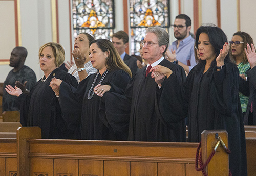 From left: Circuit Court Judges Maria Sampedro-Iglesia, Monica Gordo, John Thornton and Beatrice Butchko recite