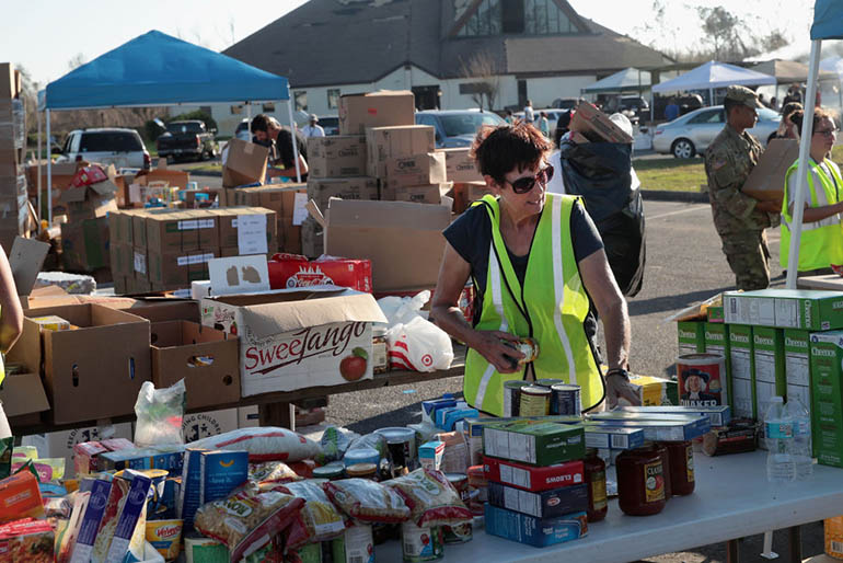 Volunteers help distribute food, water, cleaning supplies and other necessities to victims of Hurricane Michael at an aid distribution point on October 15, 2018 in Panama City, Florida. Michael slammed into the Florida Panhandle on October 10 as a Category 4 storm with sustained winds of 155 mph. (Getty Images)