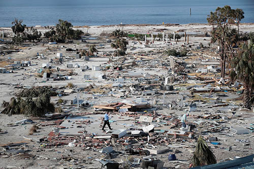 A man walks through a beachfront neighborhood that was decimated by Hurricane Michael on October 16, 2018 in Mexico Beach, Florida. The neighborhood, which had homes most of the way to the beach before the storm, is now mostly flattened. Hurricane Michael slammed into the Florida Panhandle on October 10, as a category 4 storm, claiming at least 19 lives and causing massive damage.  (Getty Images)