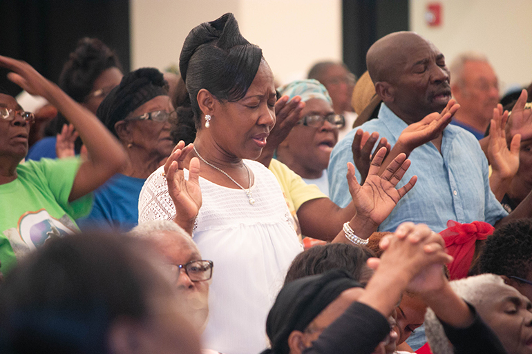 People pray during the fifth night of Jericho 2018 at Notre Dame d'Haiti Mission, Miami.