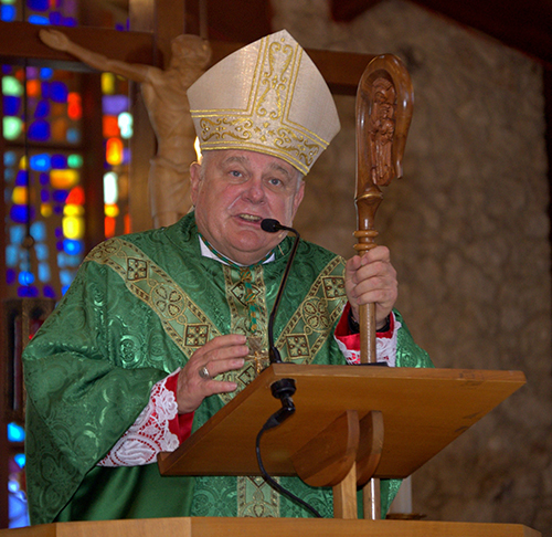 Archbishop Thomas Wenski preaches at the archdiocese's 60th anniversary Mass at Nativity Church in Hollywood. Following the Mass was a special picnic, festival and concert on church grounds.