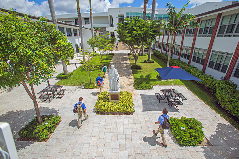 Students walk through the patio of Christopher Columbus High School in Miami, which is celebrating its 60th anniversary this year.