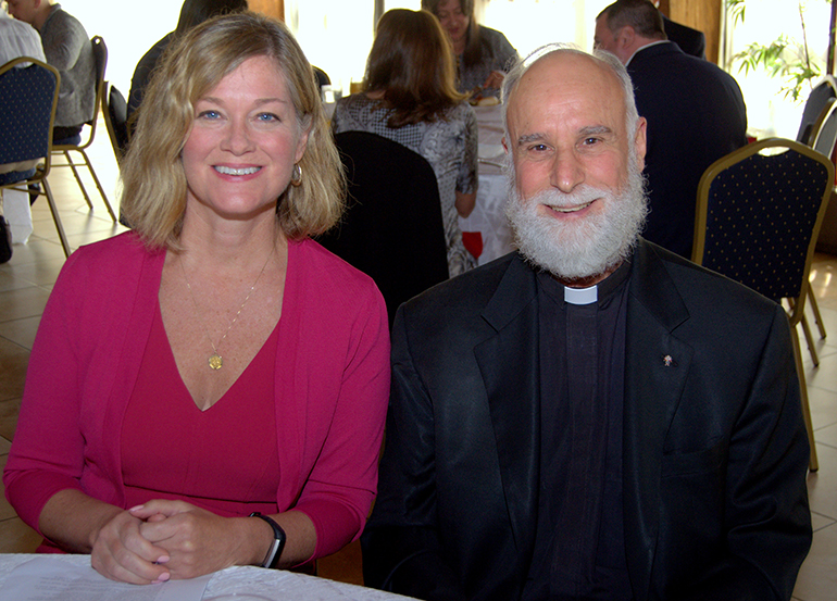 Jeanne Mancini, president of the national March for Life group, sits with bioethicist Father Alfred Cioffi at a brunch cosponsored by the archdiocesan Respect Life Office and the Cuban Association of the Sovereign Order of Malta.