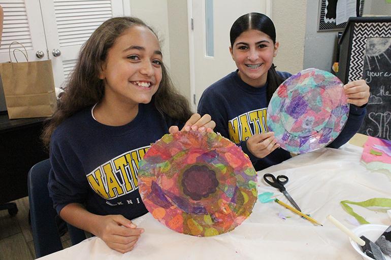 Jaden Natividad and Giann Becker show the final look of their decoupage plates.