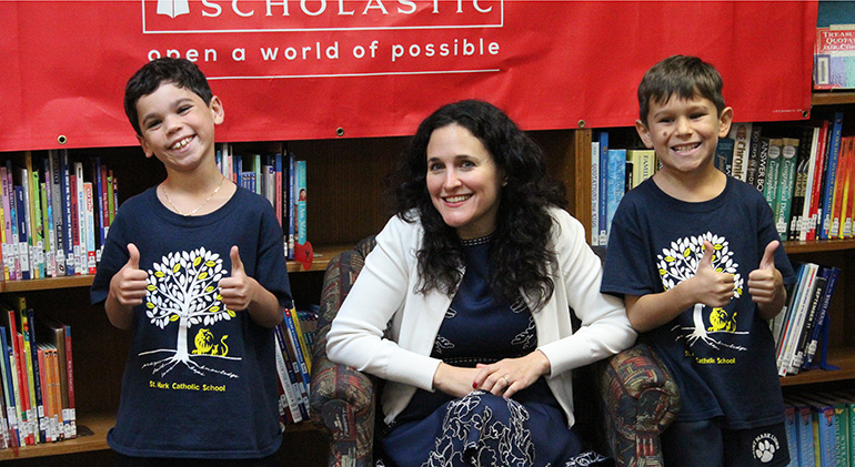 St. Mark students Thomas and Nicholas Herrera flash a thumbs up after meeting author Sarah Mlynowski.