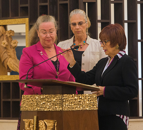 St. Catherine of Siena parishioners proclaim the readings in three languages, from left: Katy Zakas, English, Giselle Alves, Portuguese, and Eleonora Poletti, Spanish.