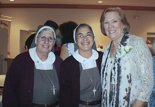 Former members of the Archdiocese of Miami Respect Life ministry, Sister Carmen Ors, left, and Sister Maria Jose Socias, of the Servants of the Pierced Hearts of Jesus and Mary, pose for a photo with Joan Crown at her retirement reception at St. David Parish Oct. 20.
