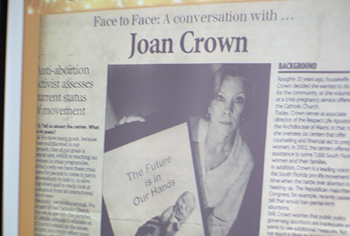 PowerPoint depicts an early newspaper article featuring Joan Crown's pro-life work.