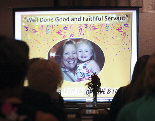 Powerpoint image of Joan Crown pictured with her granddaughter, Stella. It was shown as part of a presentation on Crown's life and times at a reception in her honor Oct. 20 at St. David Parish in Davie.