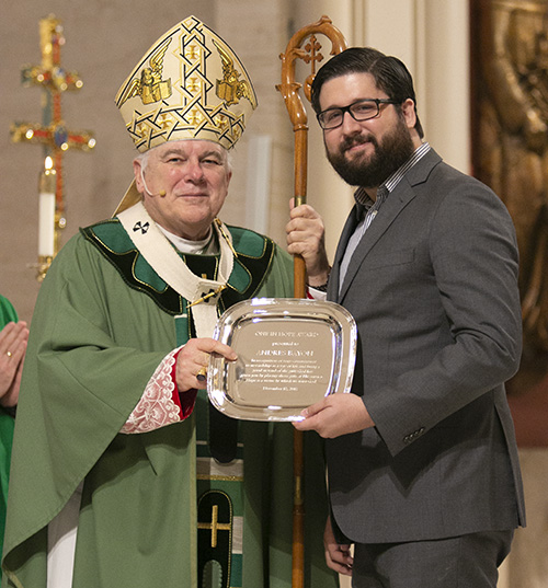 Andres Bayon of Prince of Peace Parish in Miami receives this year's One in Hope award from Archbishop Thomas Wenski. The award highlights his commitment to receiving and sharing God's gifts responsibly.The annual ThanksforGiving Mass acknowledges those who have consistently donated to the Archbishop's Charities and Development appeal, and recognizes new members of the Archbishop Coleman Carroll Legacy Society, who remembered or promised to remember the archdiocese in their will.