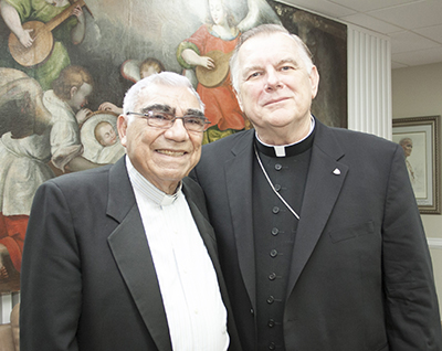 "Father Jorge Bez Chabebe is pictured here with Archbishop Thomas Wenski during a visit to the Pastoral Center in 2014. Archbishop Wenski wrote the prologue to Father Chabebe's autobiography, ""Dios Me Hizo Cura"" (God Made Me a Priest)."
