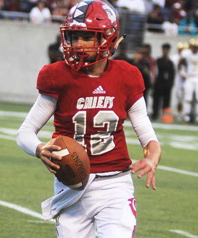 Cardinal Gibbons quarterback Brody Palhegyi runs for a 6-yard touchdown in the fourth quarter against North Marion.