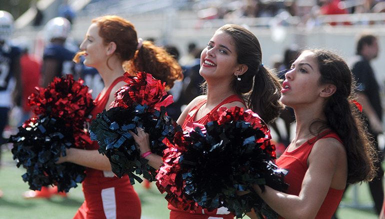 Chaminade-Madonna cheerleaders (from left) Olivia Callari, Lorrany Oliveira and Gabriella Pollio cheer on their Lions in the second half against West Palm Beach King's Academy on Saturday, Dec. 8.