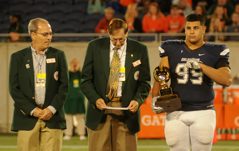 Columbus defensive tackle Dylan Perez accepts the FHSAA's Henry O. Langston Award given to the each state finalist's top scholar-athlete. Perez has committed to accepting an appointment to the U.S. Military Academy in West Point, N.Y.