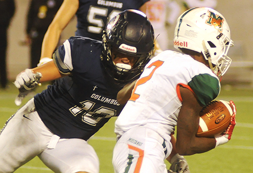 Columbus defender Elijah Morales tackles Mandarin receiver Darian Oxendine during the third quarter Dec. 8. Morales had 10 tackles and 1.5 sacks.