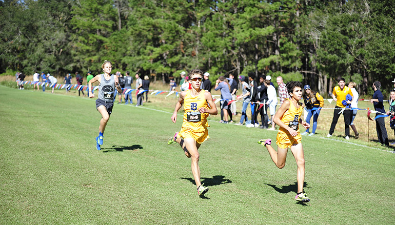 Belen Jesuit sophomore Javier Vento, right, and freshman Adam Magoulas, left, placed first and second in the 5K run at the Class 3A state boys cross-country championships to lead the school to its 10th state championship.