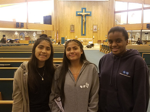 Saint Andrew students, from left, Miranda Curi, Sofia Curi, and Thereza Zephir pose for a photo after the Steve Angrisano concert.