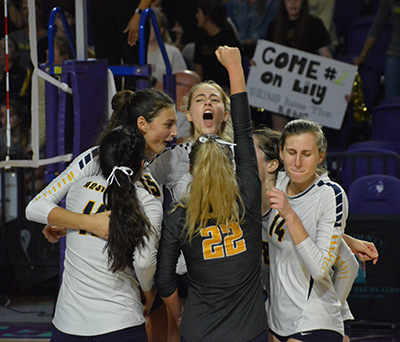 St. Thomas Aquinas volleyball players celebrate their sixth state championship after the beating Tampa Plant Nov. 17 in Fort Myers.