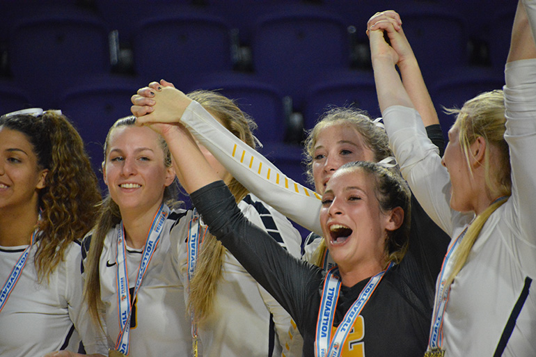 St. Thomas Aquinas volleyball players cheer after being crowned state champs Nov. 17 in Fort Myers.