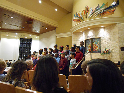 The children's choir from St. Andrew Catholic Church, directed by Mary Lou Taff, perform