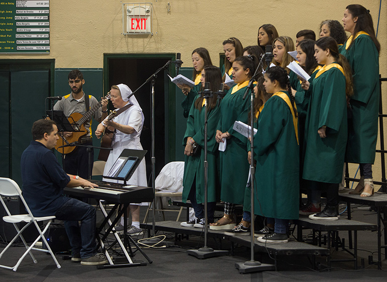 Immaculata-La Salle's choir sings during the Mass, led by  Salesian Sister Suzanne Dauwalter and fellow cantor Luis DePrada.