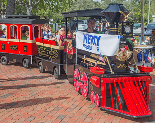 As part of the festivities on Welcome Weekend Dec. 8-9, St. Hugh parishioners and visitors get to ride Mercy Hospital's Mercy Train.