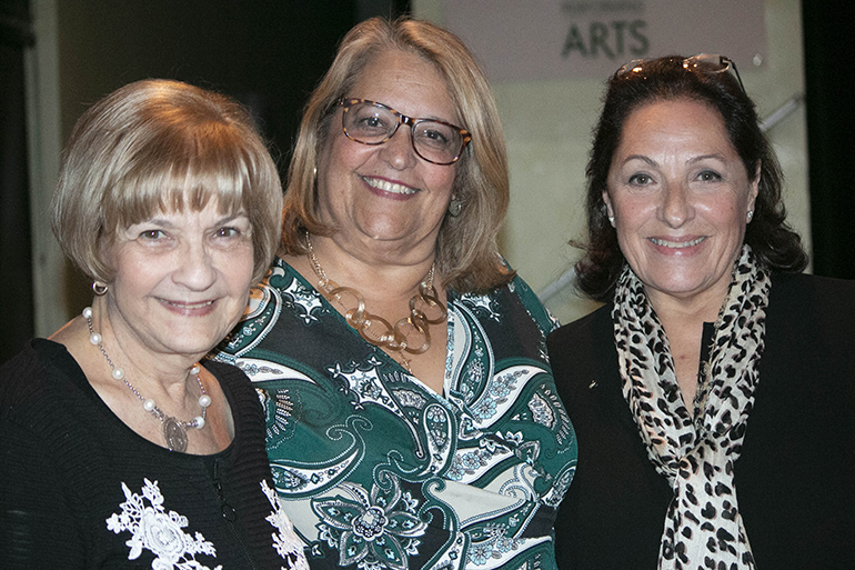 Three former Pedro Pans who helped organize the documentary showing at Immaculata-La Salle High School pose for a photo, from left: Carmen Romanach, first vice president of Operation Pedro Pan Group, Cristina Brito, development director for Immaculata-La Salle, and Carmen Valdivia, executive producer of the documentary and chair of Pedro Pan Group's Historic Committee.
