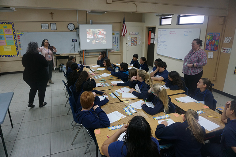St. Jerome School fifth-graders take part in a video conference with fifth graders at Donna Klein Jewish Academy. It was the first of many during which they will discuss a book both classes are reading,