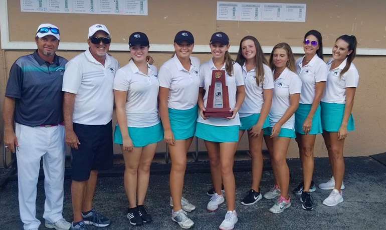 Archbishop McCarthy High School's girls golf team, who took second place statewide in Class 2A, pose with their coaches after their win at the district level. From left: Coach Carl Phillips, Coach Henry Portela, Erin O'Donnell, Natalia Jimenez, Jennifer Lilly, Rileigh Baker, Morgan Herring, Coach Jean Carver, and Coach Lauren Carver.