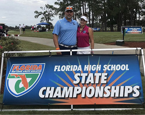 Our Lady of Lourdes senior Daniela Spillert, pictured here with her coach, Ignacio Vazquez, nearly made it an archdiocesan sweep of the 3A individual titles. Competing as an individual, Spillert took second with a 4-under 140 in the state championship.
