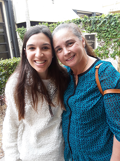 While training to become a Guardian ad Litem at St. John Neumann Parish, attorney Veronica Guerra, left, reconnected with her former religious education teacher, Rosy Schwindeman, wife of Eric Schwindeman, who spearheaded the creation of the Hope, Heart & Home ministry at the parish.