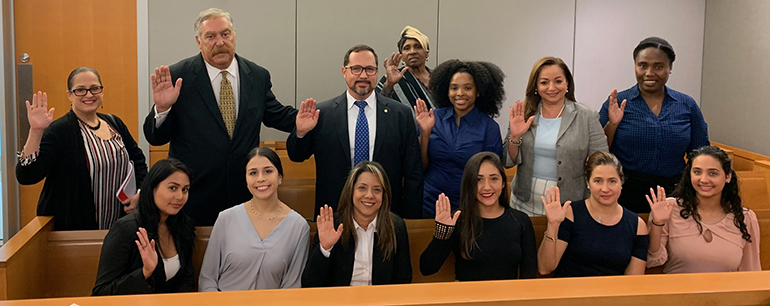 The initial class of Guardians ad Litem recruited through the  Hope, Heart & Home Ministry take their oath in the Miami Dade Children's Courthouse. They are: Lourdes Andujas, Mary Andujas, Joselito Burgos, Martha Pomares-Candia, Maria Garcia Granados, Maddy Garcia, Thais Guevara,  Taylor Hobbs, Carmen Lugo, Blanca Palomino, Louvenia Smith, Eric Schwindeman, and Cylena Stewart.