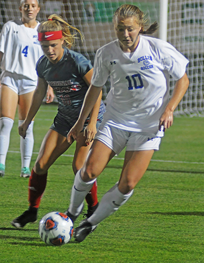 Cardinal Gibbons midfielder Chloe Depenbrook defends Bolles midfielder Avery Patterson during the first half Wednesday, Feb. 20, 2019. Bolles defeated Cardinal Gibbons 5-1. It was Cardinal Gibbons' first state final since 2009.