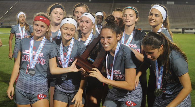 Cardinal Gibbons players pose with the state runner-up trophy Wednesday, Feb. 20, 2019. Bolles defeated Cardinal Gibbons 5-1 at Spec Martin Stadium in DeLand. It was Cardinal Gibbons' first state final since 2009.