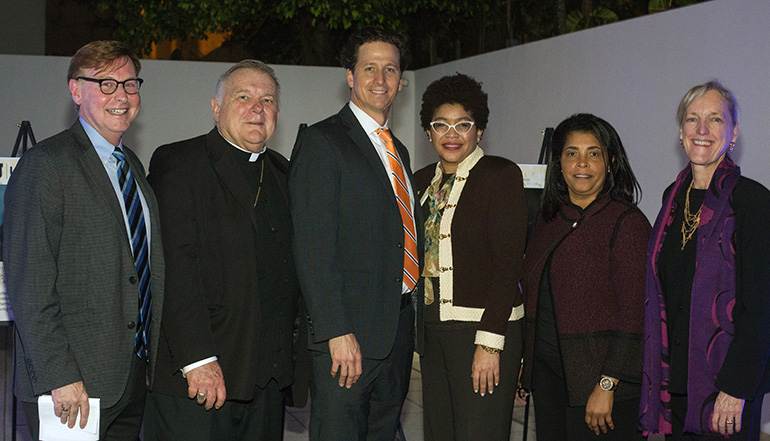 From left: Randolph McGrorty, CEO of Catholic Legal Services, and Archbishop Thomas Wenski pose with Mother Cabrini award recipient Michael S. Vastine, St. Thomas University law professor and director of its immigration clinic, as well as STU Law School Dean Tamara Lawson, STU Immigration Clinic Coordinator Yanick Laroche, and Cece Dykas, STU associate dean of academic affairs and clinical programs director.