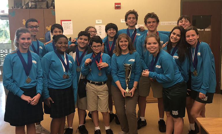 Mary Help of Christians' 2018-19 Science Olympiad team, which won the regional competition and will compete at the state level next, consists of sixth graders Mila Bond, Oscar Doughtery, and Zoryn Jean; seventh graders Zachariah Dookhan, Julia Dybas, Elizabeth James, Lucas Opperman, Nathaniel Pistorius, and Miguel Villareal-Rojas; and eighth graders Lucas Benitez, Grace Cavarretta, Melissa Dixon, Rafael Opperman, Victoria Servideo, and Thomas Zambrano. They are led by teacher Donna Hanrahan.