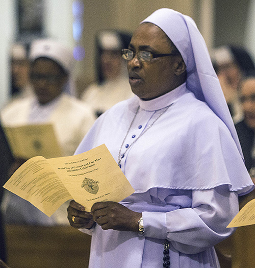 Sister Marygracious Onwukwe, marking 25 years with the Daughters of Mary, Mother of Mercy, takes part in the Mass for the World Day of Consecrated Life.