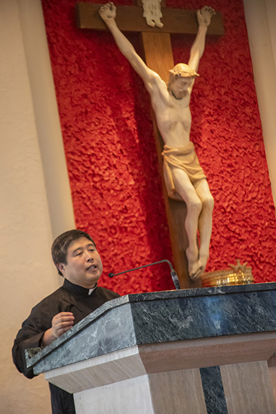Father Peter Lin, spiritual director of the Chinese Apostolate, gives the final remarks during the ancestral veneration ceremony that followed the Mass marking the start of the Chinese New Year.