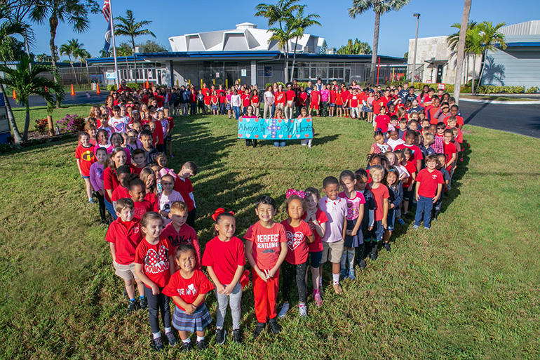 The students of St. Ambrose School in Deerfield Beach formed a heart to show their love to the fallen victims of the Marjory Stoneman Douglas tragedy. They also held a short prayer service Feb. 14, the anniversary of the tragedy.