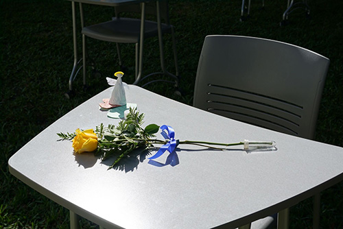 To mark the one-year anniversary of the shooting at Marjory Stoneman Douglas High School in Parkland, students at St. Thomas Aquinas High School in Fort Lauderdale set out 17 desks in one of the school's interior hallways, in memory of each of the victims. On the desks they placed a yellow flower, a candle and an angel. Throughout the day, classes would stop by and say a prayer, listen to a reflection or spend a moment in silence.