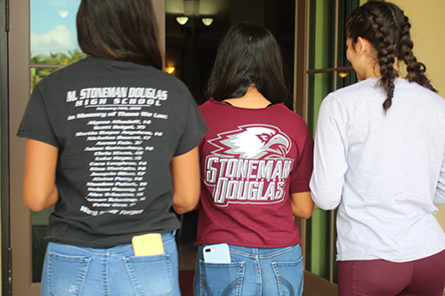 Valentina Zuniga, left, and her sister Gabriella, center, along with Camila Escobar, right, enter Mary Help of Christians in Parkland to pray for friends lost in the shooting at Marjory Stoneman Douglas High School Feb. 14, 2018. Mary Help of Christians held a holy hour on the first anniversary of the tragedy so that people could pray for the victims, their grieving families, and peace.