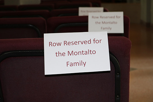Seats at Mary Help of Christians bear the names of the Montalto family. Nearly 30 members of the family attended a holy hour at 2 p.m. Feb. 14, the one-year-anniversary of the Parkland school shooting where Gina Montalto, 14, was killed. She was in ninth grade at Marjory Stoneman Douglas High School.