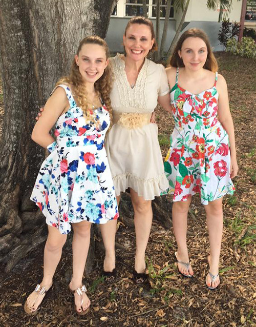 Mary Help of Christians parishioner Alison Carew poses with her twin daughters Madison, left, and Mackenzie. The girls are in 10th grade this year at Marjory Stoneman Douglas High School and are trying to move forward after the death of their classmates.