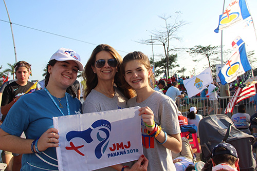 "Amanda Merino, 18, poses with her mother, Miriam, and sister, Alessandra, 13 at World Youth Day in Panama. Amanda canceled her trip to World Youth Day in Krakow because of her father's illness. ""It was awesome because we were there together as a family unit and we knew it was what my dad would have wanted,"" Merino said of World Youth Day Panama. ""If he had been alive, he probably would have been there too."""