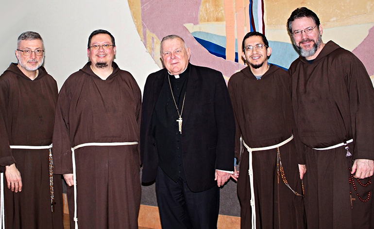 Father Nicholas Mormando, far left, and Brother Lombardo D'Auria, second from left, are the first of an expected three Capuchin Franciscan friars who will work at the newly-erected St. Pio Friary located at St. Jerome Parish in Fort Lauderdale. They are pictured here with Archbishop Thomas Wenski and representatives of the community's New Jersey/Southeast USA Province: Provincial Minister Father Remo DiSalvatore, far right, and Provincial Council member Father Francisco Arredondo, second from right.
