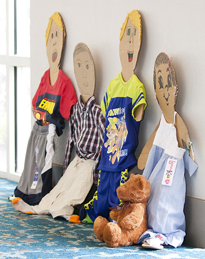 On display at the Miami Archdiocesan Council of Catholic Women's 2017 convention were dozens of children's clothes which had been donated for needy children.